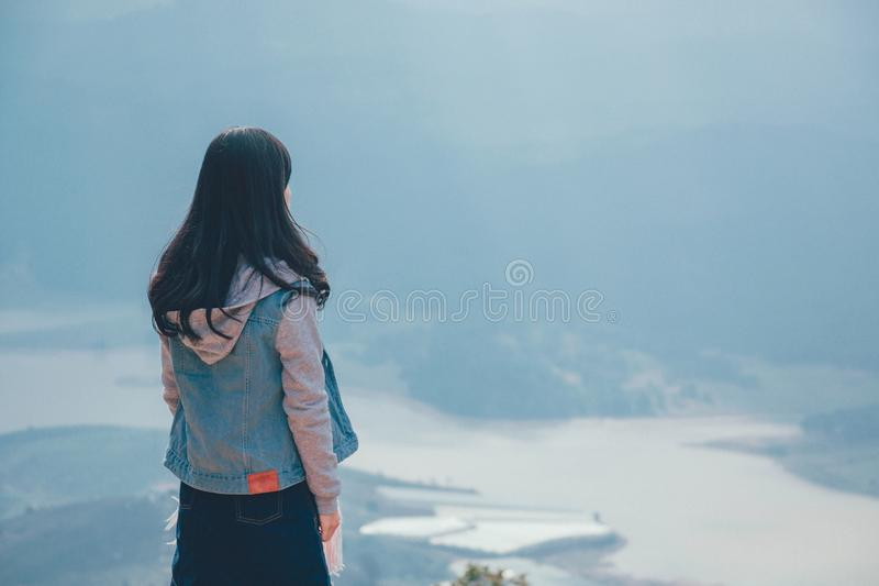Woman in Gray and Blue Zip-up Hoodie Standing on the Cliff stock photos