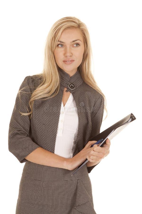 Woman gray business dress folder look side stock photography