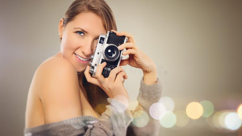 Woman With Gray Dress Holding Camera royalty free stock photos
