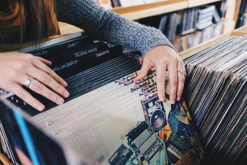 Woman In Gray Knit Sweater Holding Vinyl Records Free Public Domain Cc0 Image