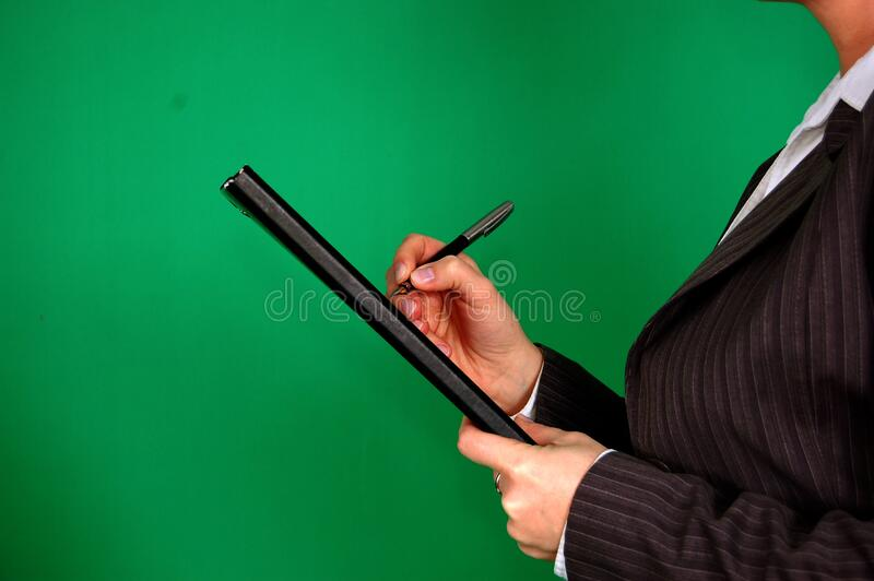 Woman In Gray Pinstripe Blazer Holding Black And Gray Stylus Pen And Black Pad Free Public Domain Cc0 Image