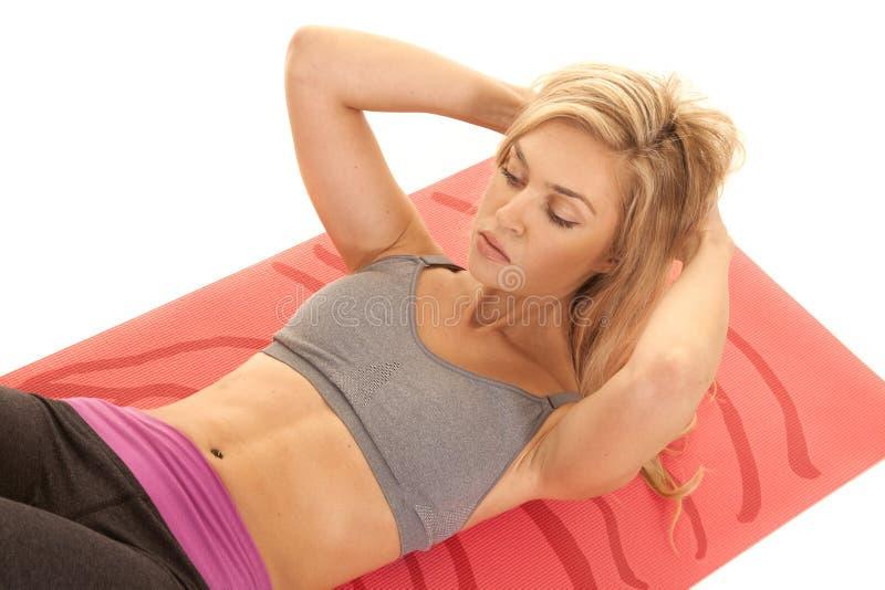 Woman gray sports bra sit up close stock photos