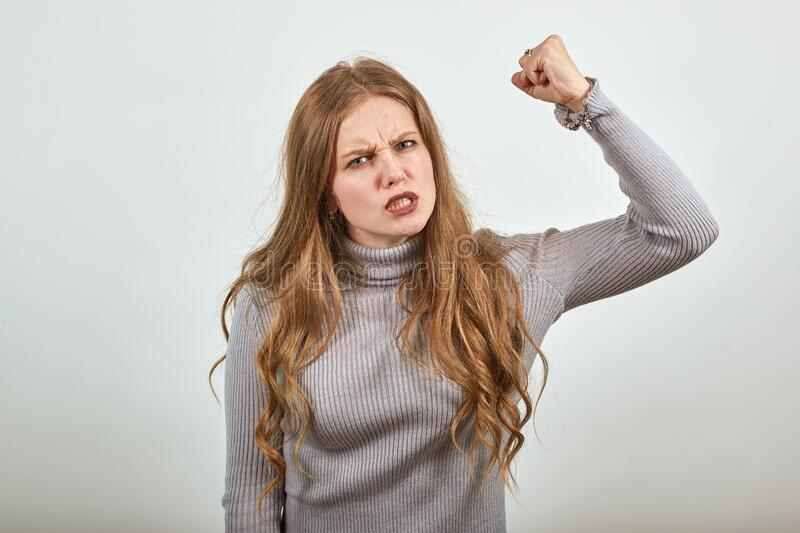 [woman-gray-sweater-irritated-angry-lady-shakes-her-fist-anger-young-beautiful-red-haired-171487285.jpg]