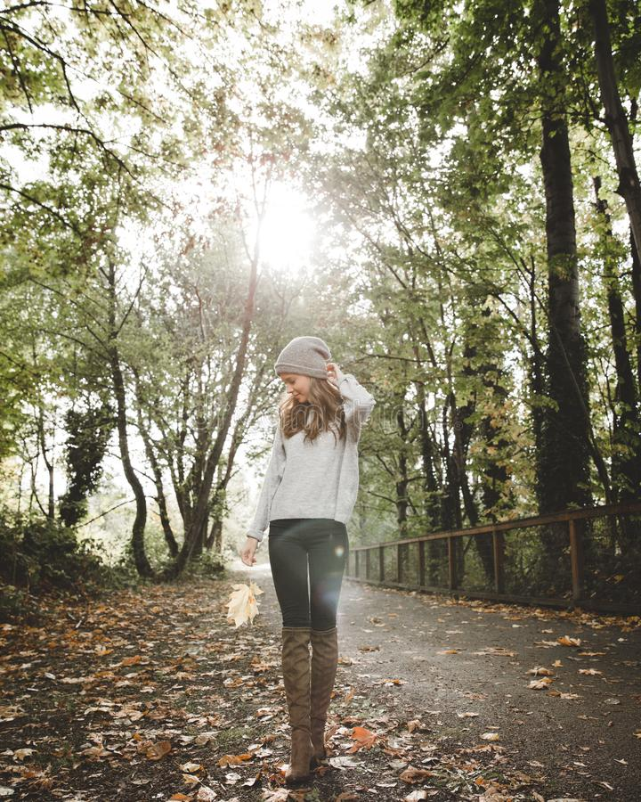 Woman in Gray Sweater Standing Between Forest Trees royalty free stock photography