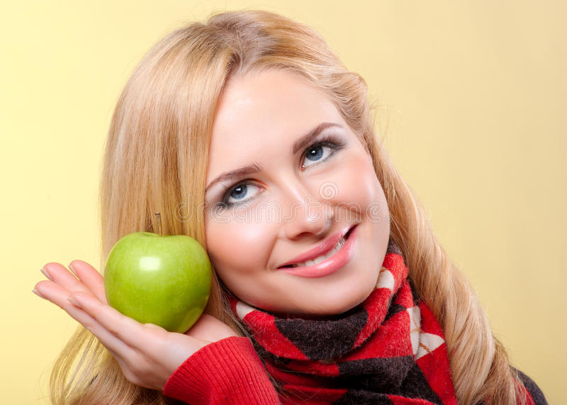 Download Woman with green apple stock photo. Image of clothing - 22281388