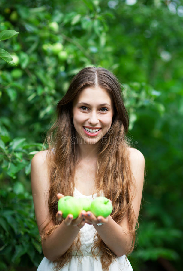 Download Woman with green apples stock image. Image of harvesting - 25780403