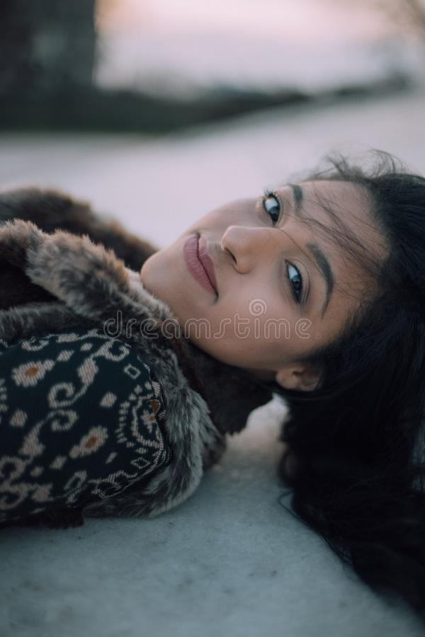 Woman In Green And Beige Jacket Lying On White Surface Free Public Domain Cc0 Image