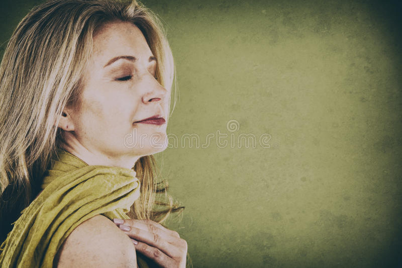 Woman on green royalty free stock photography