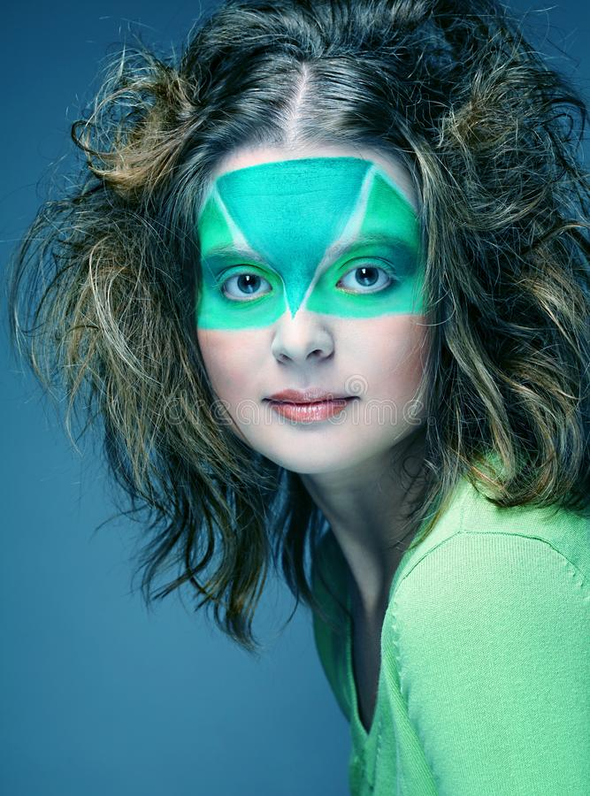 Woman with creative make-up. Woman with green creative make-up royalty free stock photography