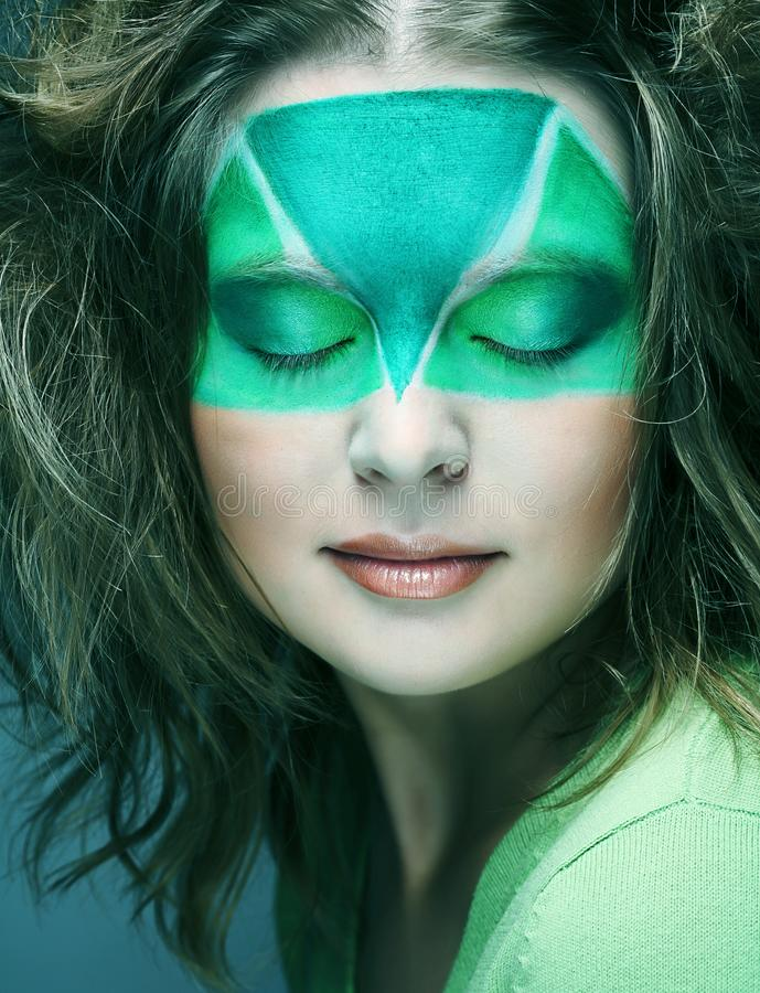 Woman with creative make-up. Woman with green creative make-up royalty free stock photos