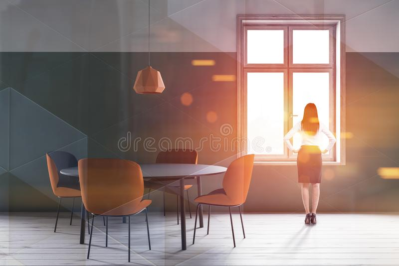 Woman in green dining room stock images