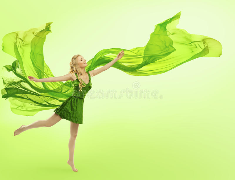 Woman in Green Dress, Blowing Cloth, Young Girl Silk Fabric. Woman in Green Dress with Blowing Cloth on Wind, Young Girl Posing Open Hands, Silk Fabric Fly over