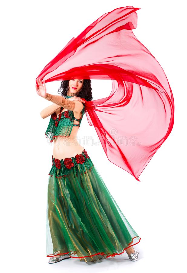 A woman in a green dress Oriental dancer dancing erotic dancer. Sexy girl dancing belly dance.  on a white background stock images