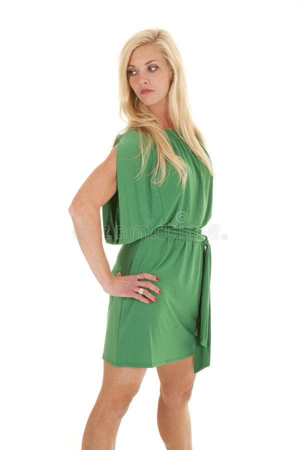 Woman green dress serious look side stock photo