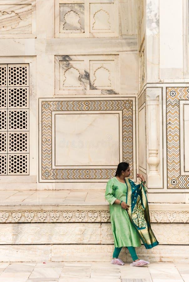 Woman in green dress at the Taj Mahal in Agra stock photo