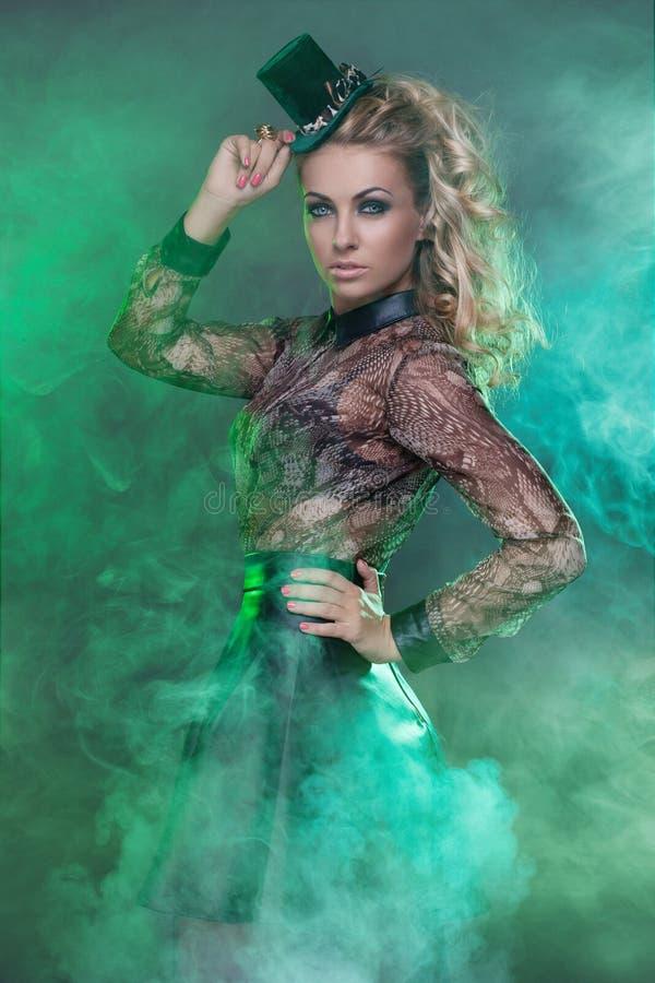 Woman in green fog stock photo