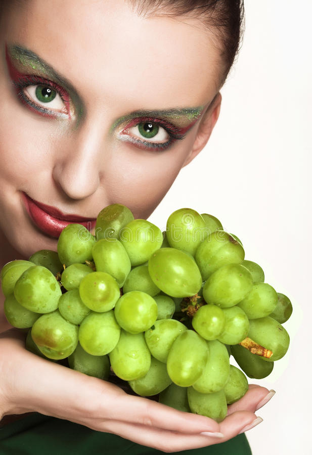 Woman with green grape. Beautiful young woman with green grape isolated on white stock photos