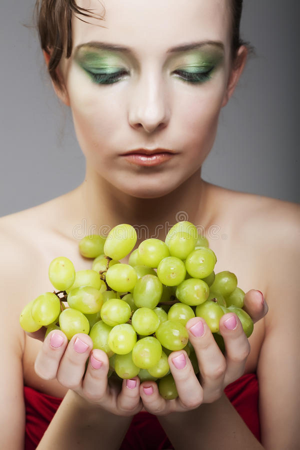 Download Woman with green grapes stock photo. Image of mouth, beauty - 11168756