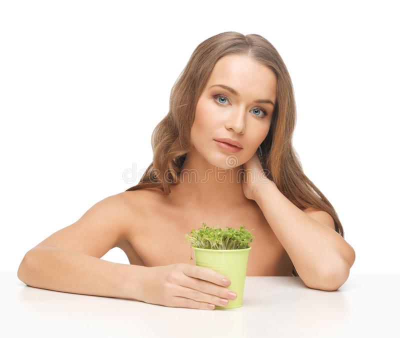 Woman with green grass royalty free stock photos