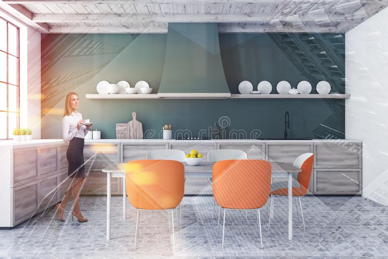 Woman in green kitchen with table stock image