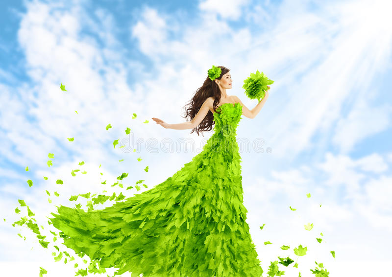 Woman Green Leaves Dress, Nature Fashion Beauty Girl in Leaf Gown royalty free stock image