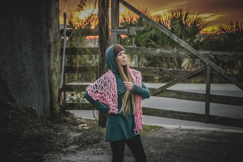 Woman in Green Long-sleeved Dress Standing Near Brown Wooden Fence stock photo