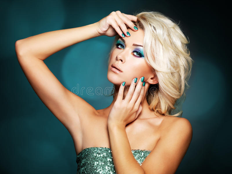 Woman with green nails and glamour makeup of eyes stock photos