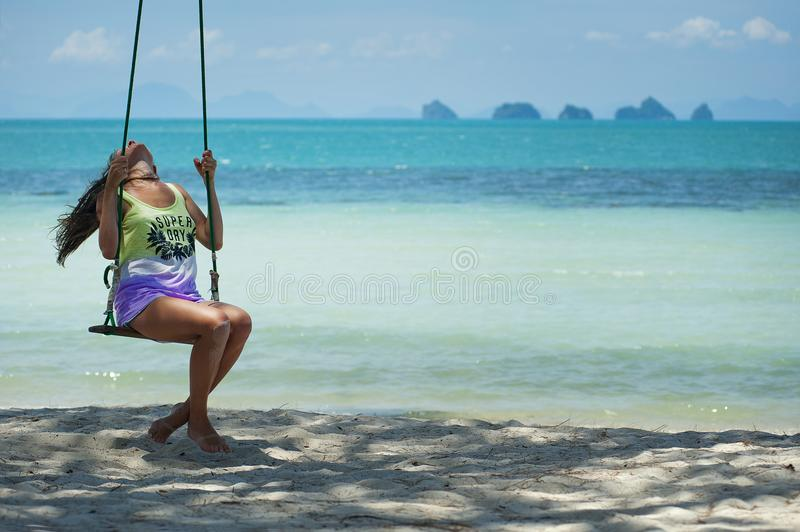 Woman in Green and Purple Tank Top Sitting on Brown Swing stock photos
