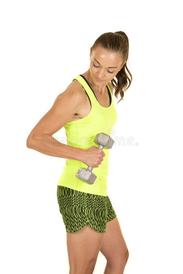 Woman green tank top fitness hold weight side looking down royalty free stock photos