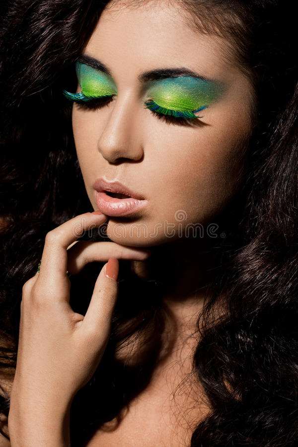 Woman with green visage stock images
