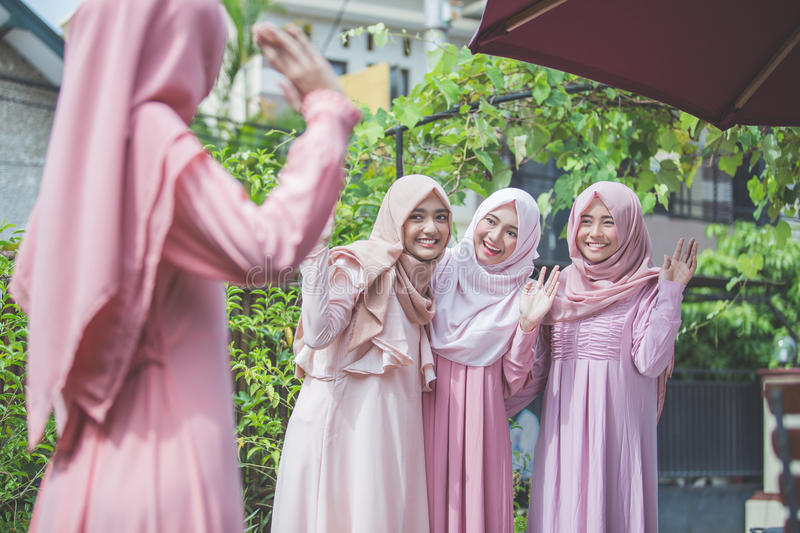 Woman greeting her friend and say hi stock image image of greeting portrait of women greeting her friend and say hi asian female muslim m4hsunfo