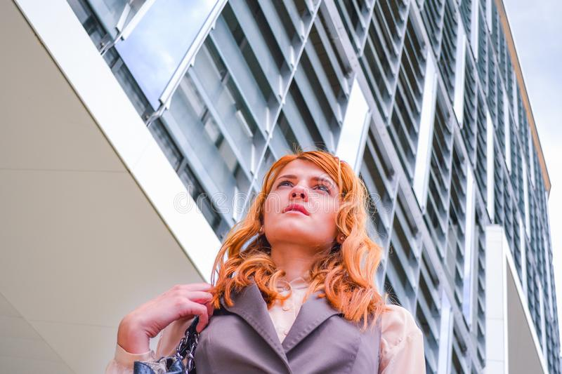 Woman in Grey Blazer Low Angle Photography Near Building stock images