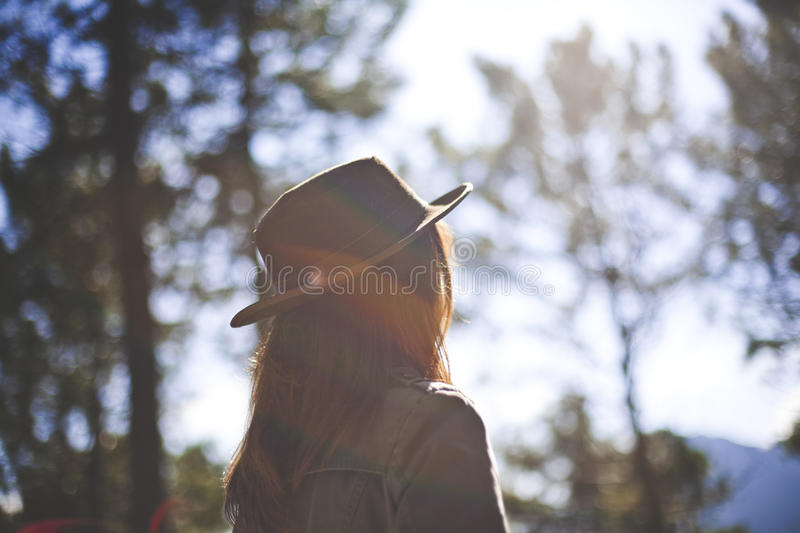 Woman In Grey Denim Jacket Wearing Hat Surrounded By Trees During Daytime Free Public Domain Cc0 Image