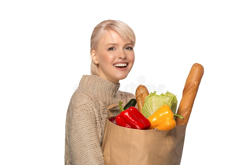 Woman with groceries shopping bag stock image