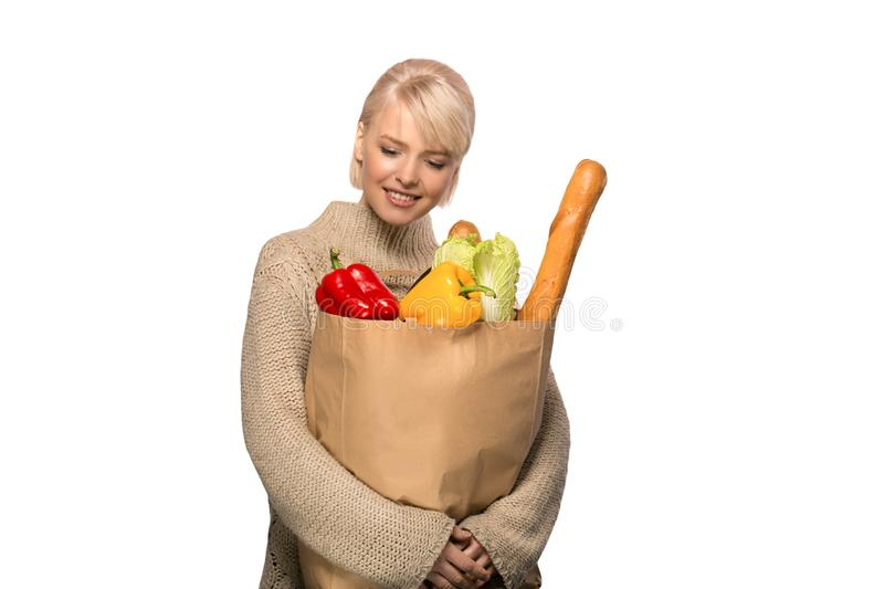 Woman with groceries shopping bag stock photos