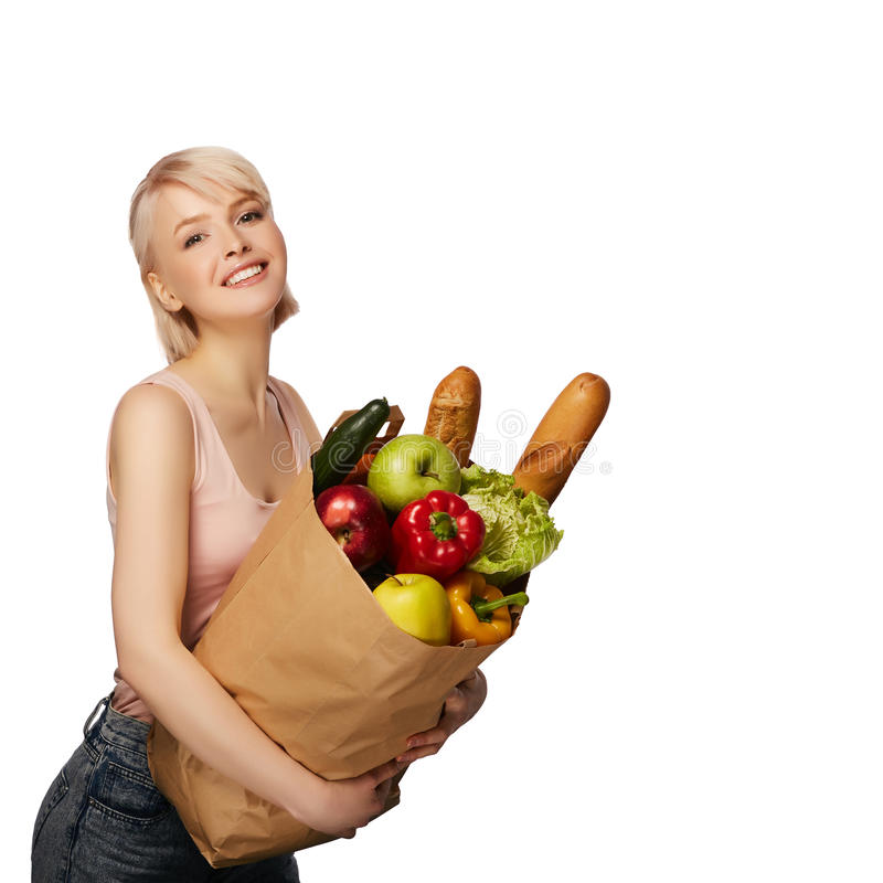 Woman with groceries shopping bag royalty free stock photos