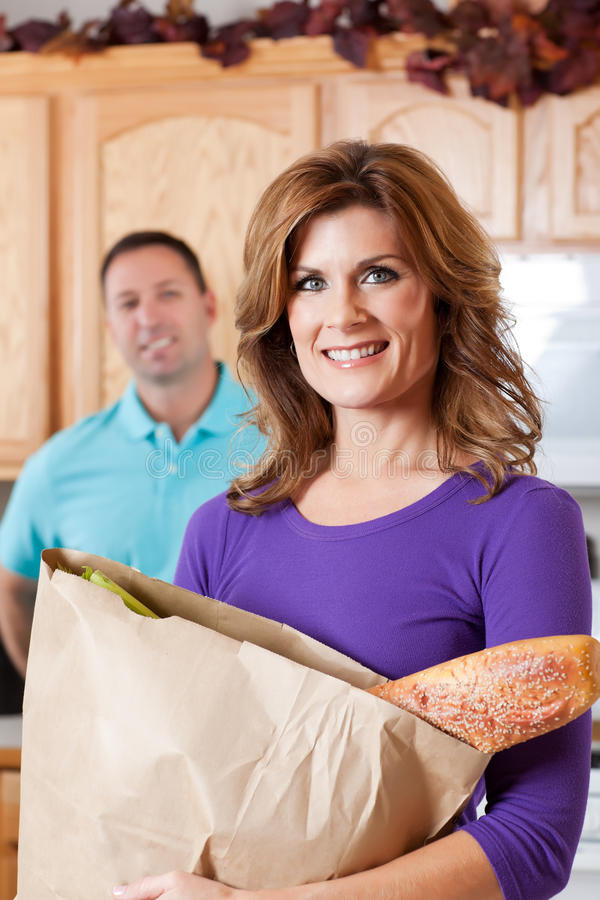 Woman with grocery stock photo