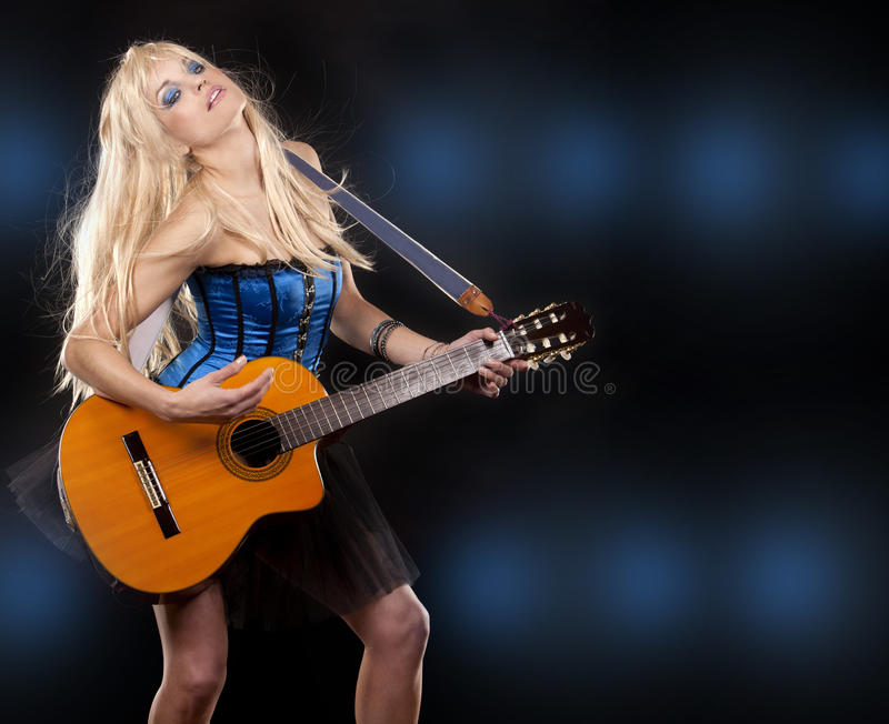 Download Woman and guitar stock photo. Image of beautiful, music - 24192298