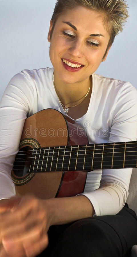 Woman and guitar royalty free stock images