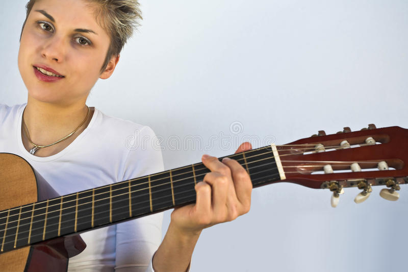 Woman and guitar stock photos
