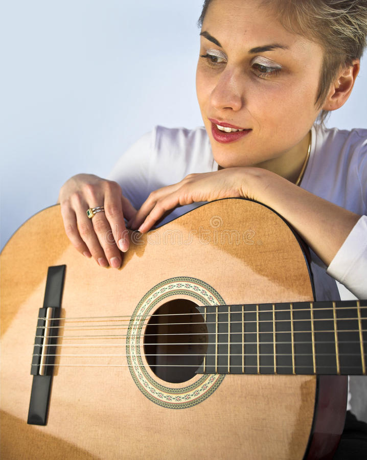 Woman and guitar stock images