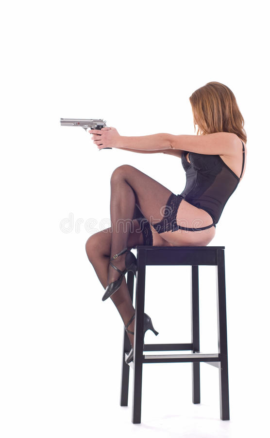 Download Woman with gun stock image. Image of heels, black, wesson - 11156171