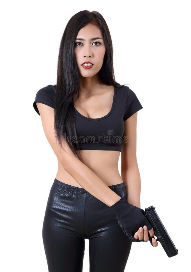 Download Woman and gun stock photo. Image of beautiful, criminal - 94077548