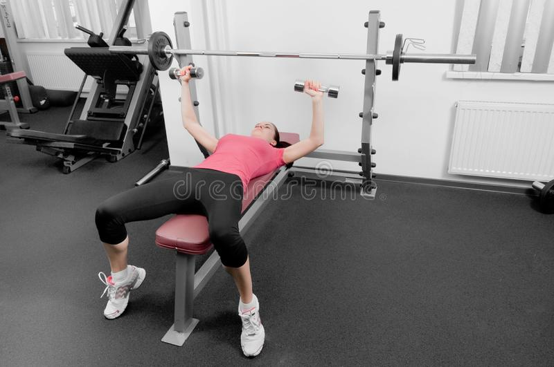 Woman in a gym royalty free stock photography