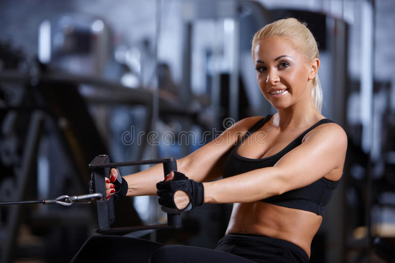 Download Woman at the gym stock image. Image of machine, body - 14855423
