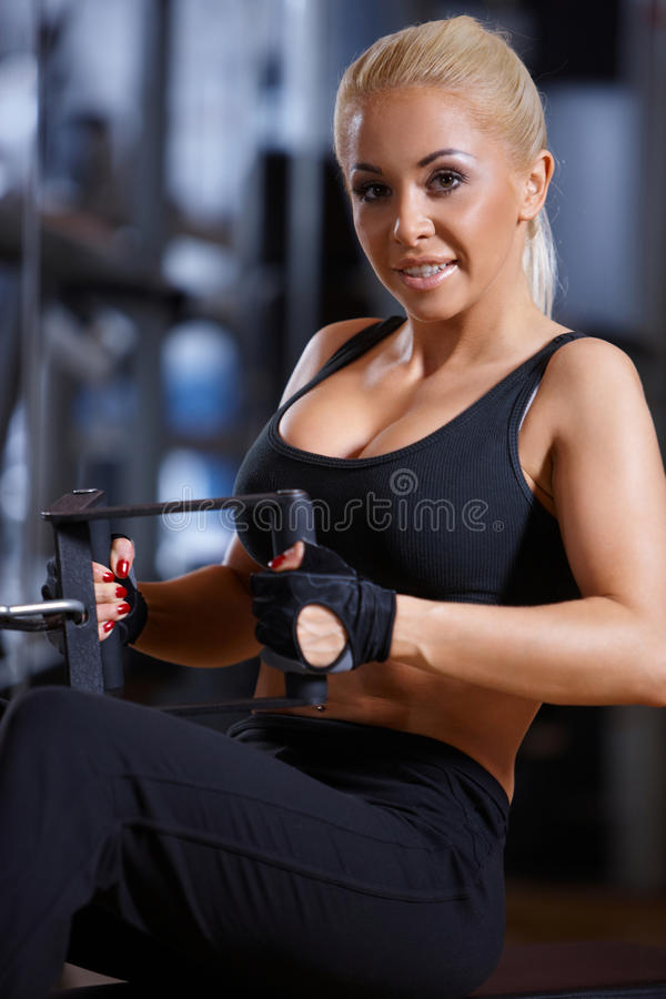 Download Woman at the gym stock photo. Image of strength, machine - 14855428