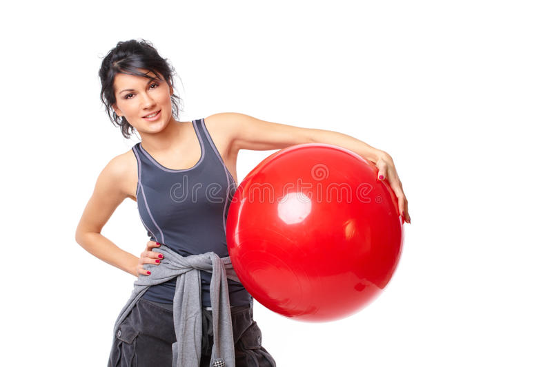 Woman with gym ball. Beautiful young woman with gym ball exercising, isolated on white background stock image
