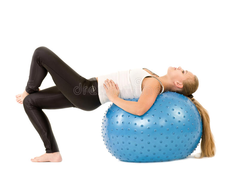 Woman in gym with a blue ball