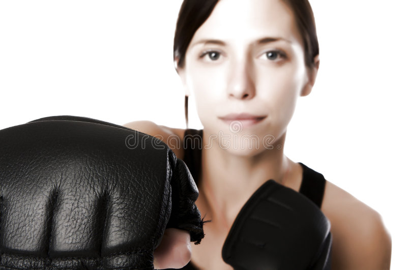 Woman in gym clothes, with boxing gloves, strength royalty free stock images