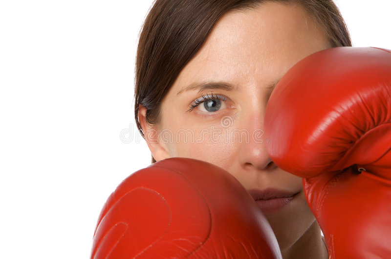 Woman in gym clothes, with boxing gloves, strength stock image